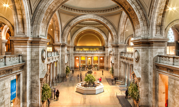 The grand interior of the Met's Great Hall with its domes, arches, pillars and marble floors
