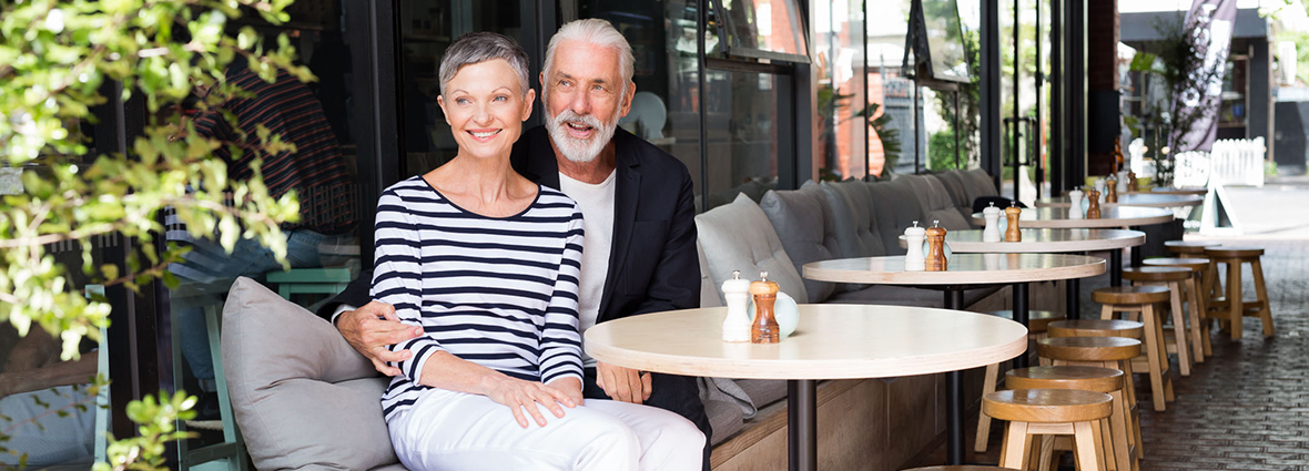 Elderly couple enjoying lunch outside